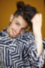 Headshot Misha Estrin Happy