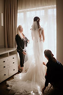wedding planners assisting bride
