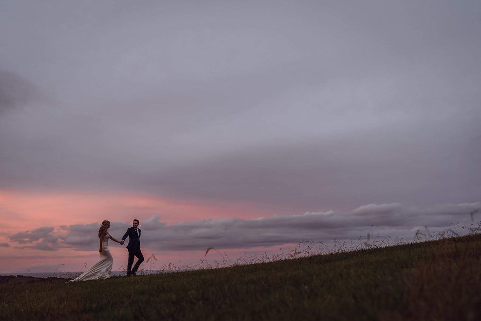 Beautiful Wedding Couple walking on waiheke island New at sunsetZealand