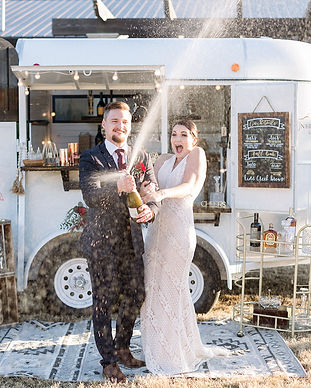 Excited Wedding Couple Popping Champagne