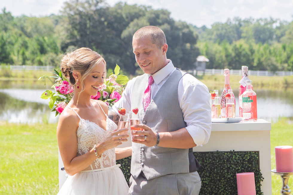 Wedding Couple Toasting at Bar in front of lake