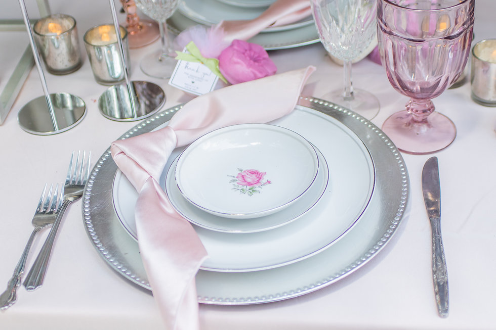Wedding dinner plates in silver with pink roses, and pink wedding soap favors
