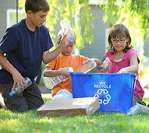Tree kids recycling plasic garbage