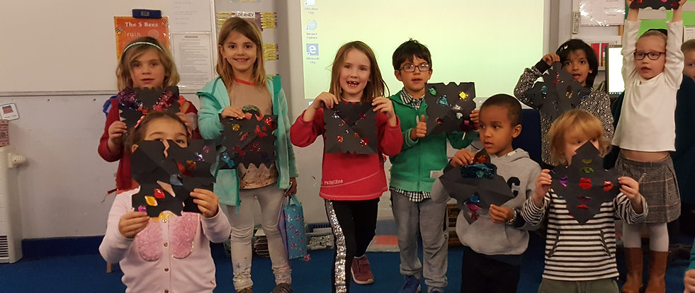 Group of children holding paper snowflakes