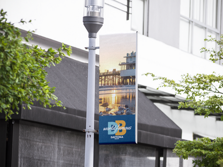vertical-banner-hanging-from-a-light-pol