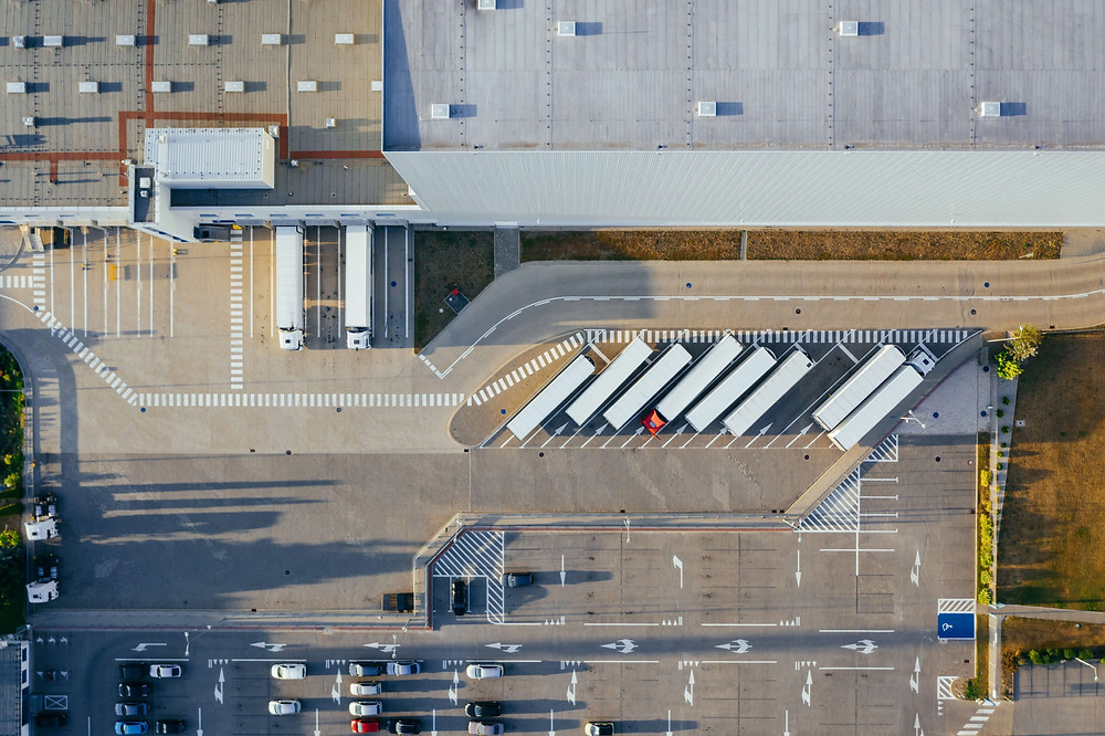 logistic center with EV truck vehicles and fleet management