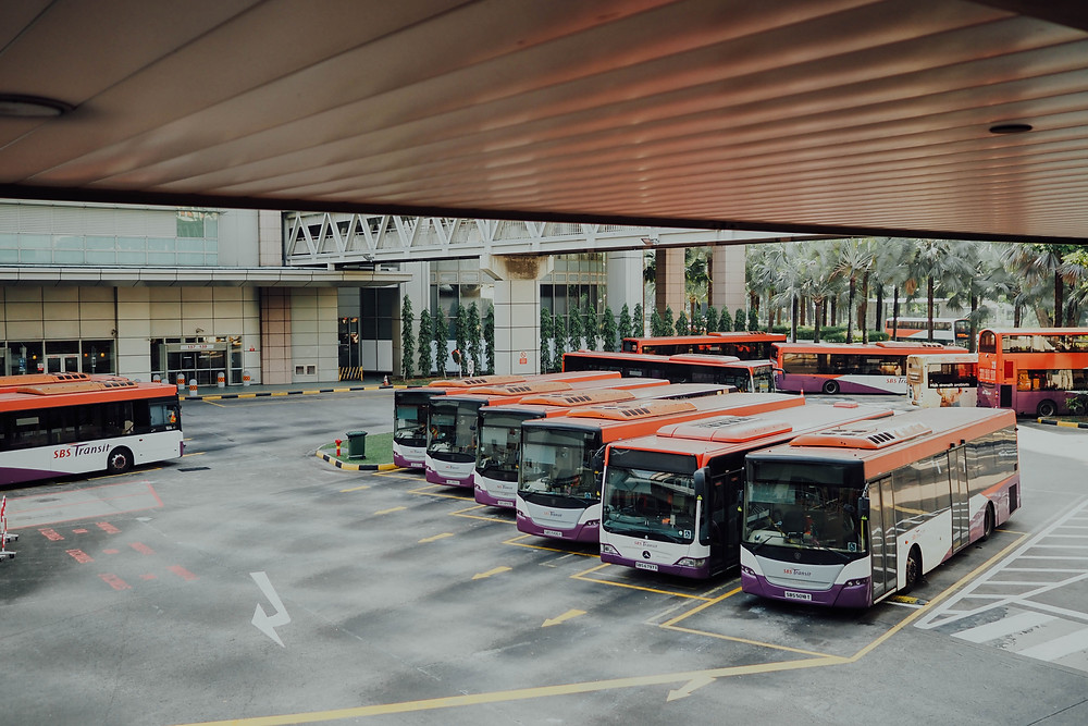 electric busses charging at depot
