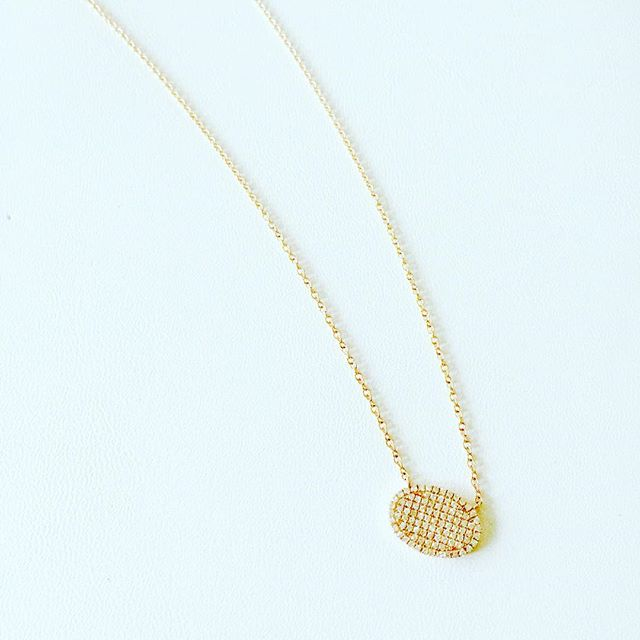 Clean, classic and a little bit different. Oval pavé diamond necklace is in stock