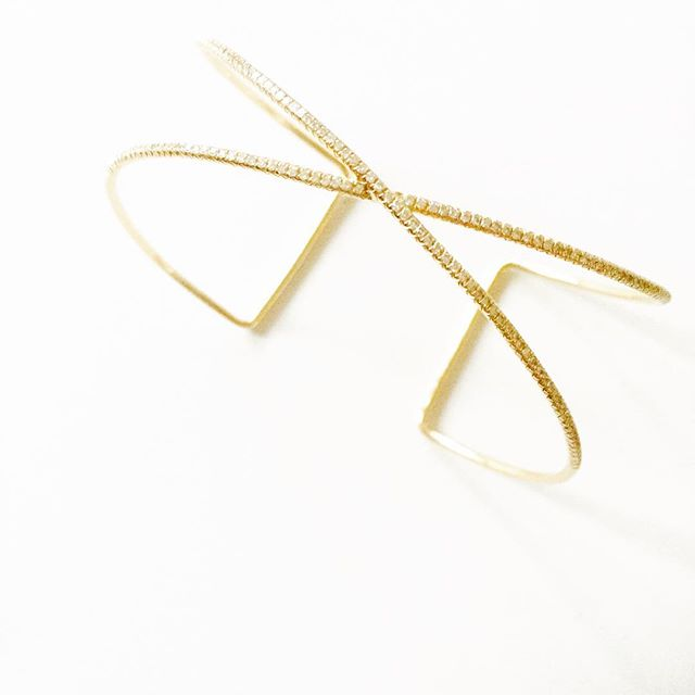 Our gold and diamond X cuff is a staple