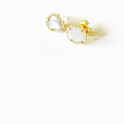 Diamond slice earrings surrounded by diamonds and set in 14k yellow gold. Contact us for orders