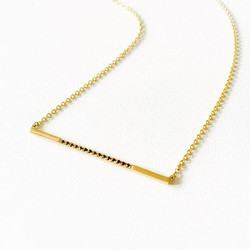 New take on the bar necklace. Black diamonds and 14k yellow gold
