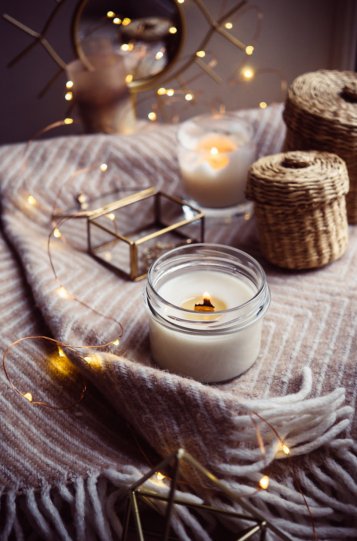 Burning hand-made candle with wooden wic