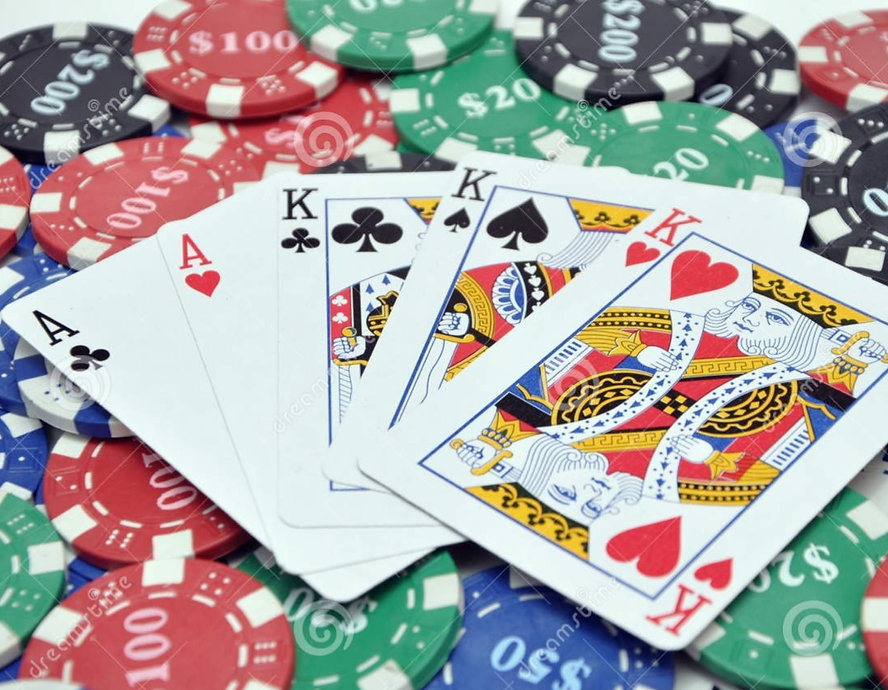 poker-chips-full-house-cards-23593667_edited_edited.jpg