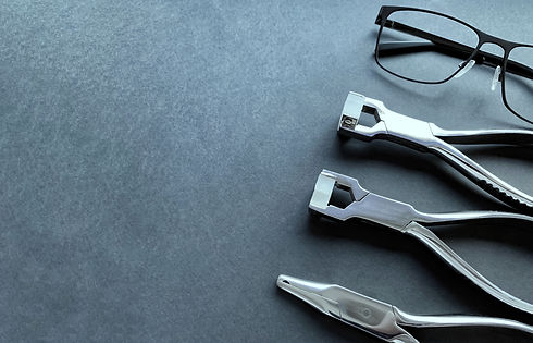 eyeglass repair tool.  metal pliers.  sc