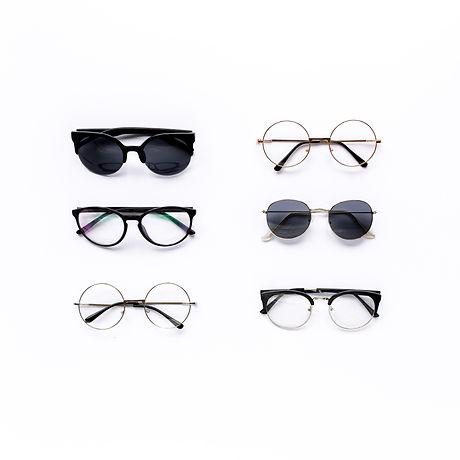 Female sunglasses on white background. F