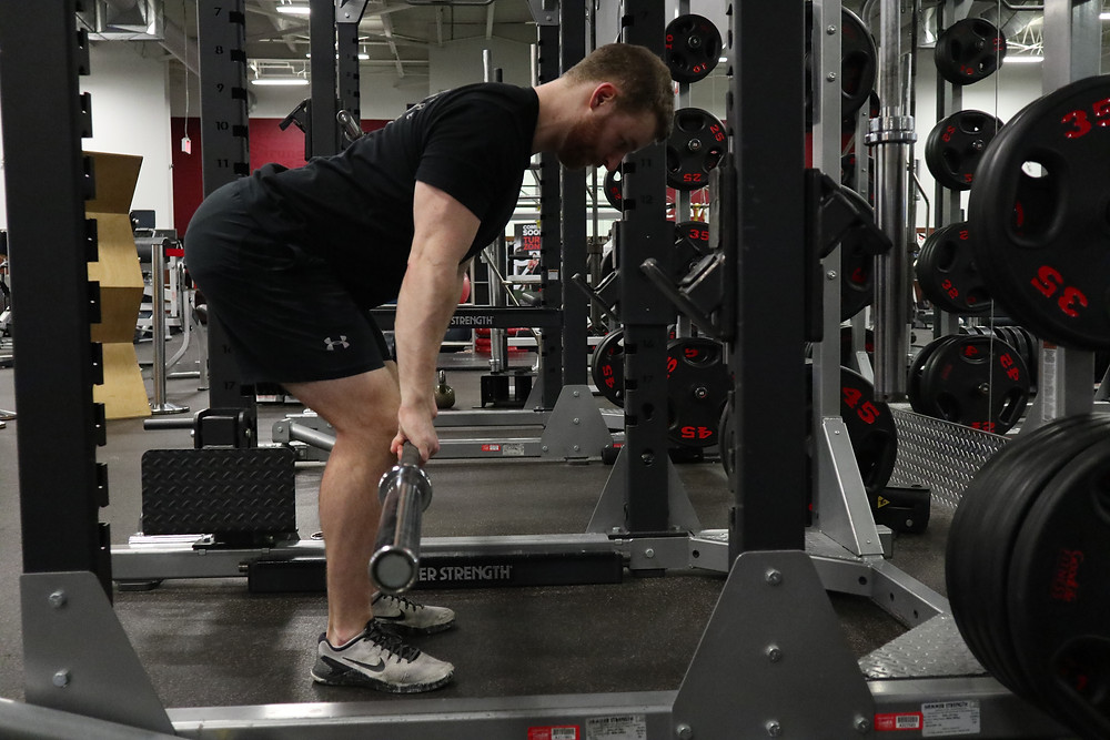 deadlift position in black clothing