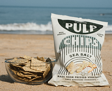 Sea salt pulp chips in a bowl, on the beach