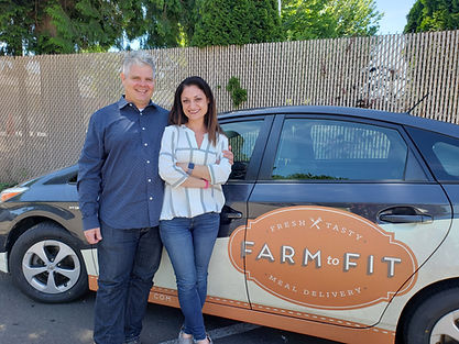 Founders of Farm to Fit in front of a delivery car