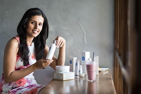 Malika Sadani, CEO of The Moms Co, with their products