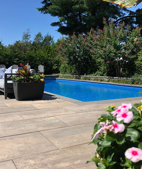 unilock pavers swimming pool outdoor furniture flowers bluestone outdoor living