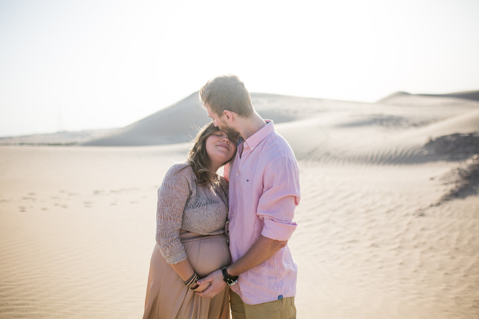 Lovely expecting couple in Desert.