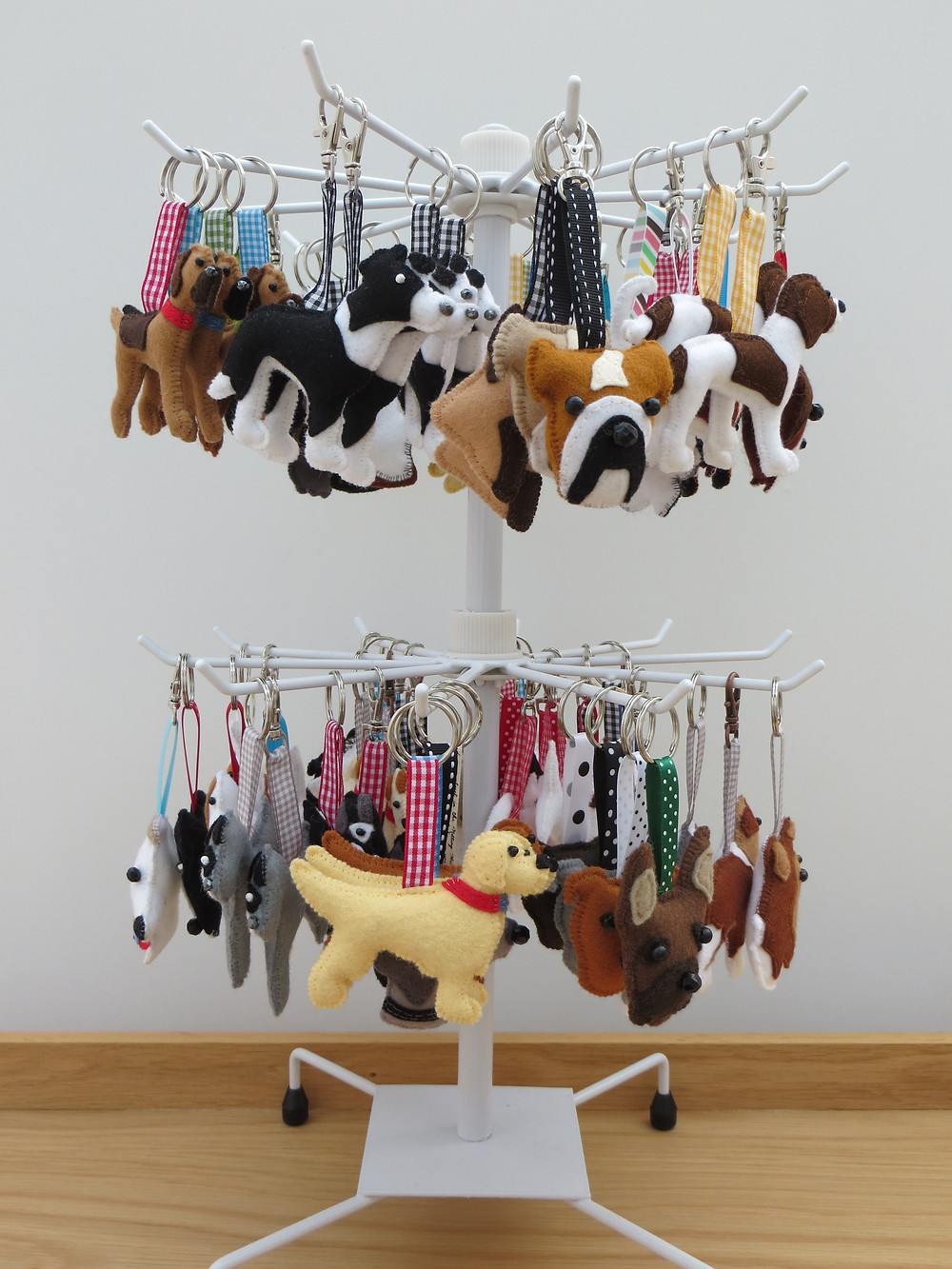 a carousel of hand sewn felt dog breed keyrings and bag charms