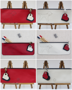collage of leather red and white pencil cases with a full border terrier laser cut motif to the front side only