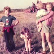 When my dad was harvesting the crops, we always took a picnic to the harvest field. The baby brother I'm holding here is now running the farm!