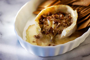 baked brie crusted with pecans and drizzled with honey