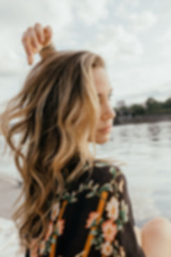 Woman with beach waves and lived in highlights colored, cut and styled by Tessa Matsis Smith on Willamette River in Portland Oregon