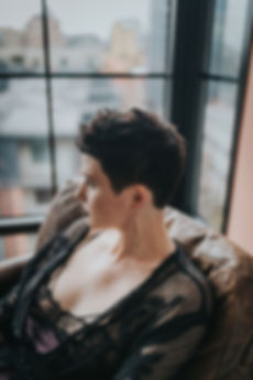 Woman wearing short hair cut by Tessa Matsis Smith with texture in an urban apartment in Pearl District, Portland