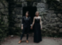 Two women holding handsin from of a Witch's Castle in Forest Park, Oregon
