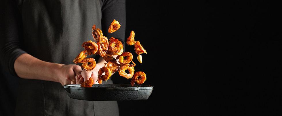 professional-chef-prepares-shrimps-lango