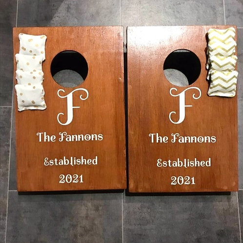 Stained personalised cornhole boards with 8 x throwing bags