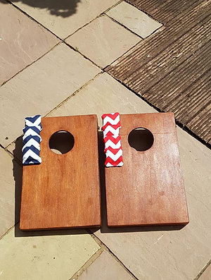 Stained cornhole boards and throwing bags