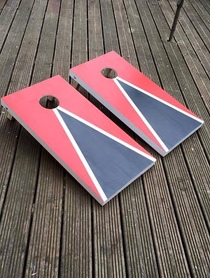 Red and Black cornhole boards and 8 x throwing bags