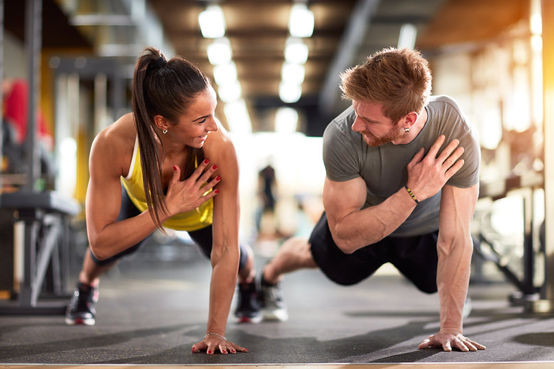 Man and woman strengthen hands at fitne