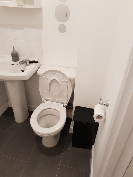 Repaired corner of bathroom after leak from upstairs