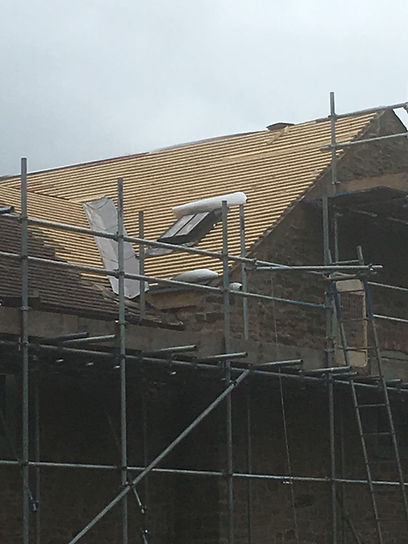 Roof repairs underway with scaffold access
