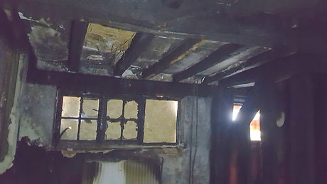 Severe fire and smoke damage to walls and ceiling