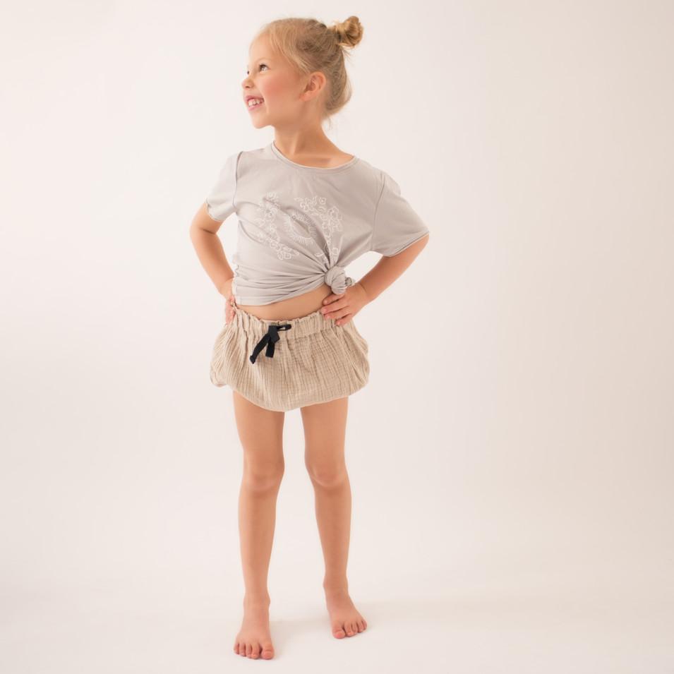 girl, studio, commerical, natural light, shirt, shorts