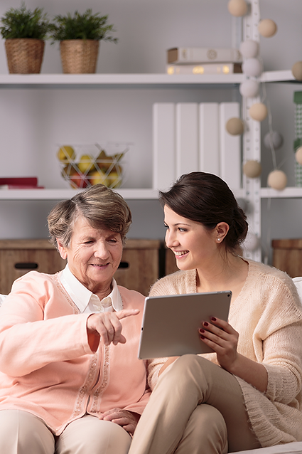 woman and young woman on tablet.png