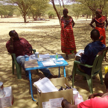 Joshua and community health workers conducting outreach to Rendille mothers
