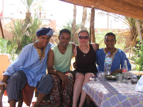 Enjoying local foods and friends near Zagora, Morocco