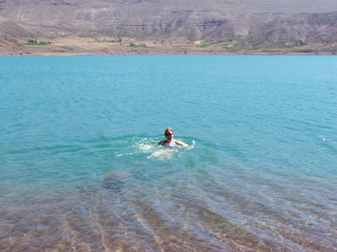 Taking a dip in Lake Imilchil, Morocco