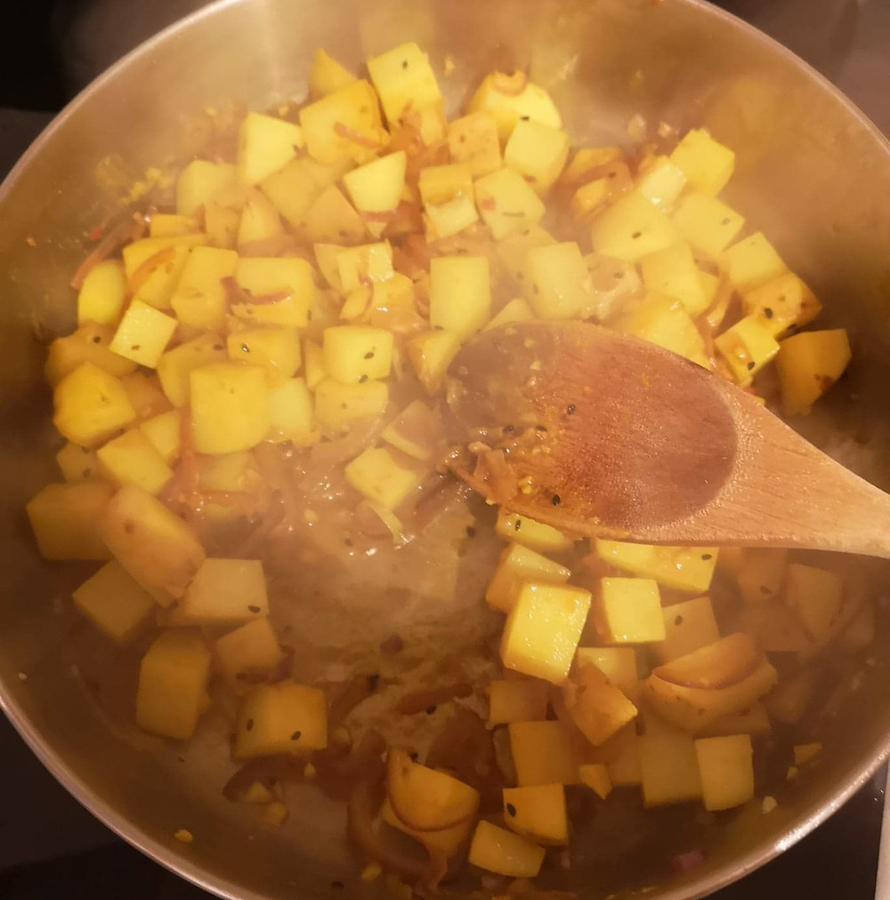 Saag aloo with not your nana's piccalilli kraut