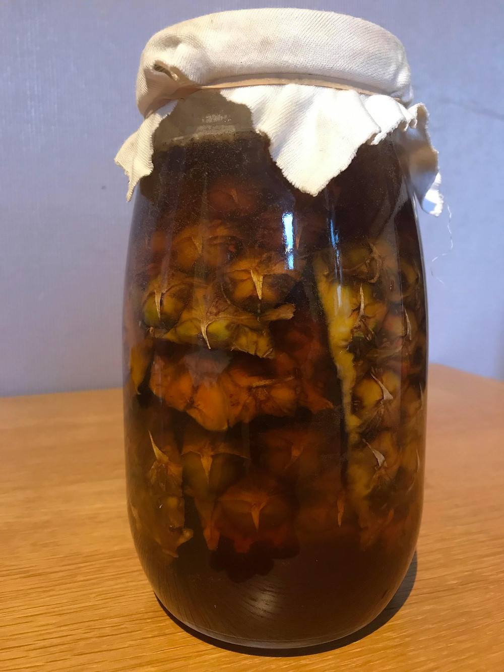 Pineapple peel fermented with brown sugar and cinnamon to make Tepache