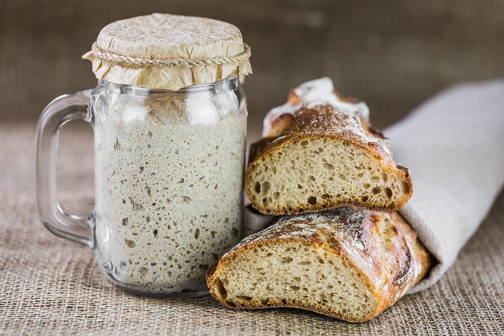 Fermented sourdough starter with crusty sourdough loaf