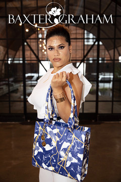 Gabby_standing-blue-bag-final-w-logo.jpg