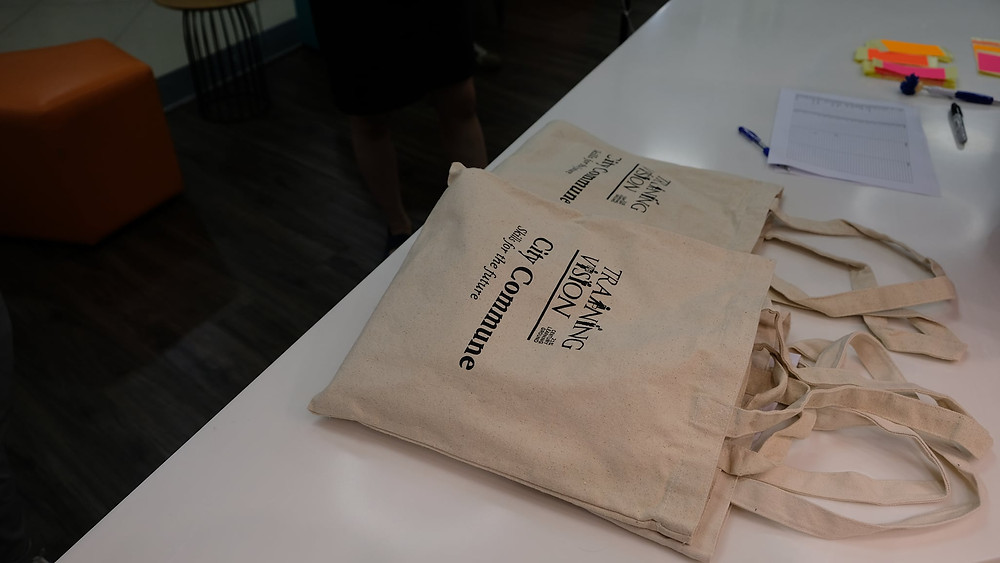 Tote bags lying on top of a table